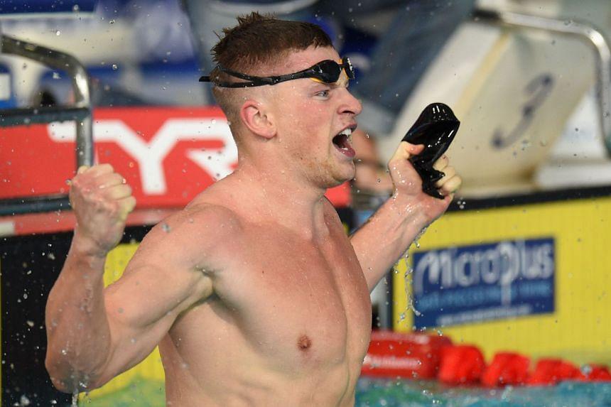 Peaty celebrates winning gold in the men's 100m breaststroke.