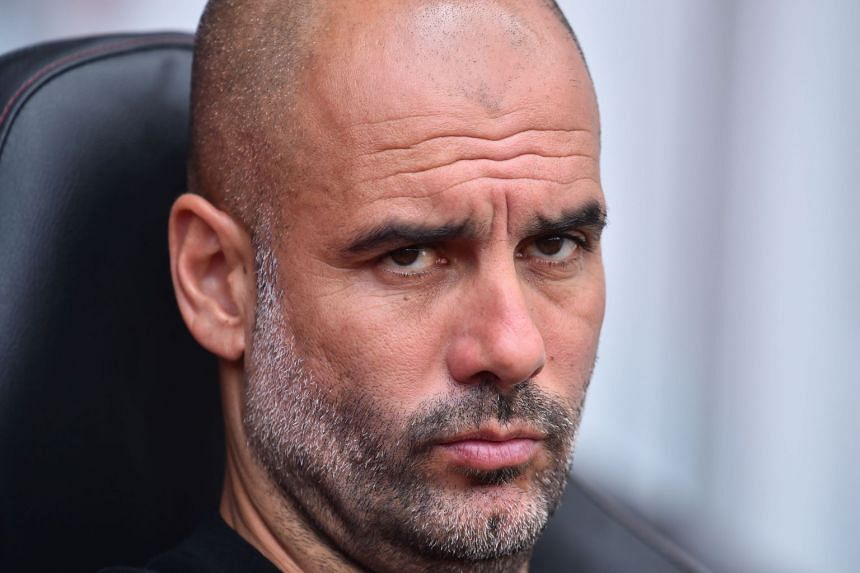 """""""I am ready, I am ready,"""" says Guardiola (above) of City's title defence."""