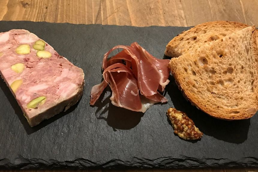 Unfussy food that is proficiently executed: Slices of Serrano ham and toast accompany a homemade pate.