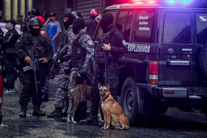 Members of different security forces stand guard and after an explosion that reportedly targeted President Nicolas Maduro, in Caracas, Venezuela, on Aug 4, 2018.