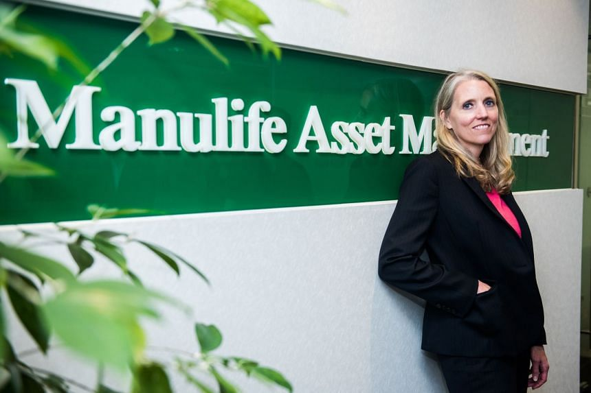 Manulife Asset Management's Susan Curry is upbeat about the US banking industry, saying the firm expects higher interest rates and a softening regulatory tone to enhance earnings.