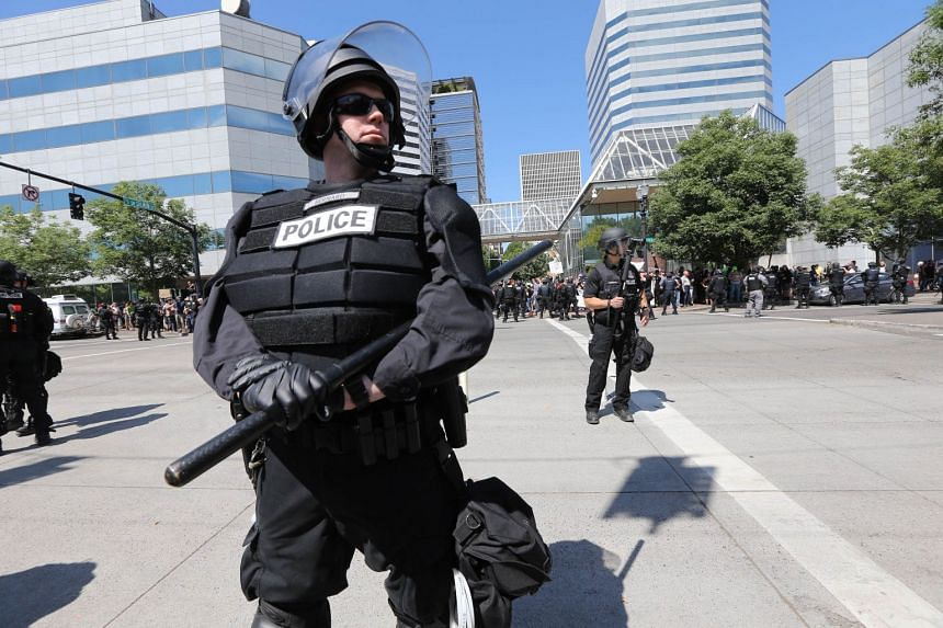 Riot police stand guard as right-wing demonstrators hold their rally.