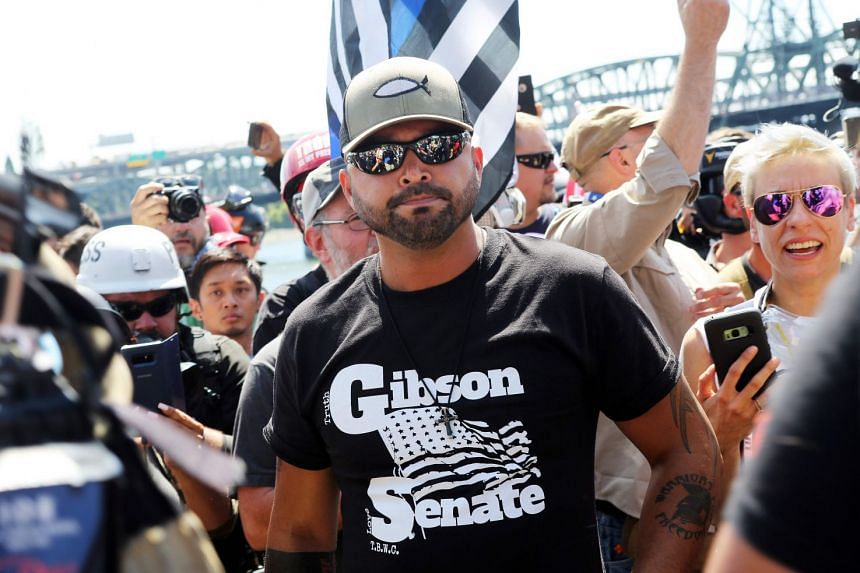 Rally organiser Joey Gibson stands with alt-right activists.