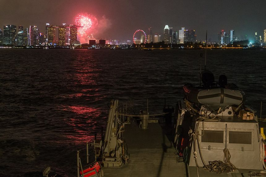 Fireworks are seen from the RSS Fearless out at sea facing the Marina Bay floating platform during the National Day Parade preview on Aug 4, 2018.