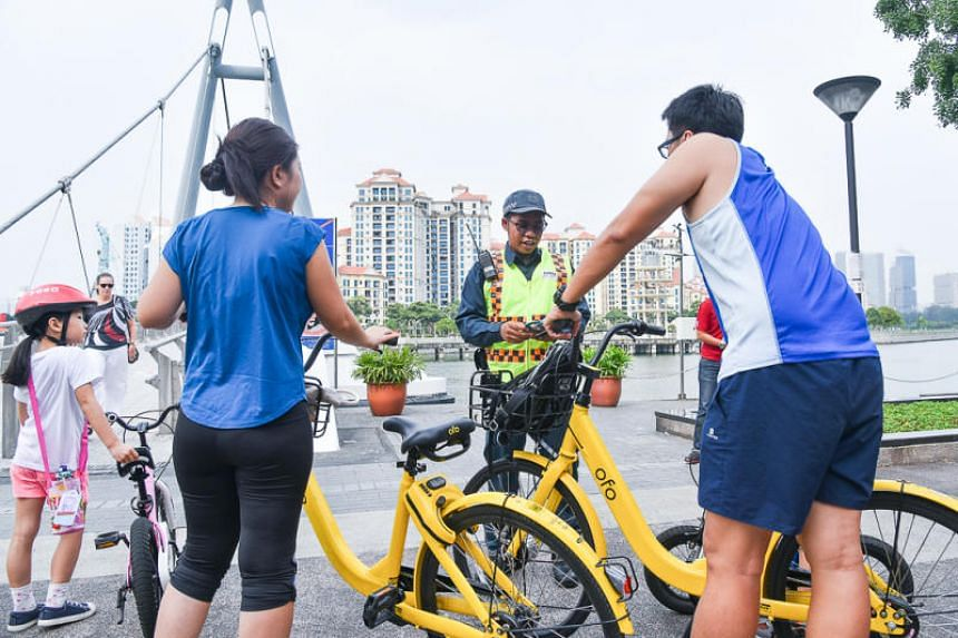 Auxiliary police officer Muhammad Hanafi Azeman sharing with cyclists on the Active Mobility Act on Aug 4, 2018.