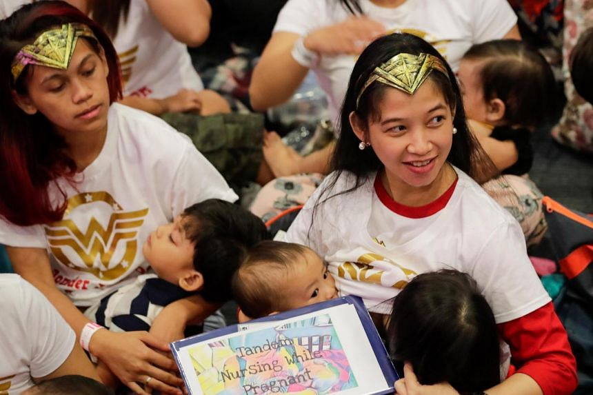 Filipino mothers dressed in Wonder Woman costumes breastfeed their children during a breastfeeding event in Pasay City, Philippines, on Aug 5, 2018.