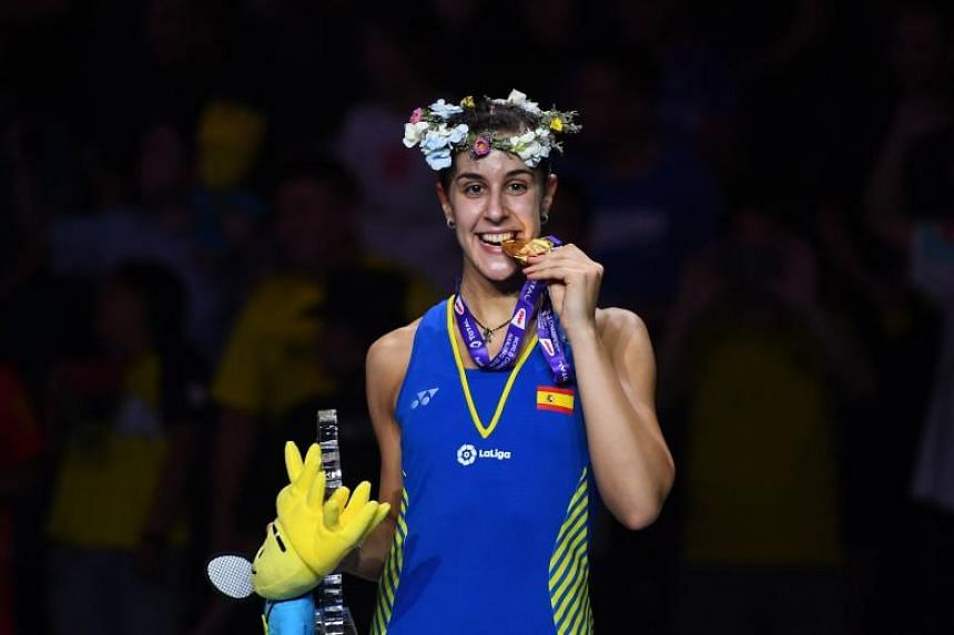 Spaniard Carolina Marin is now the reigning world and Olympic champion thanks to an imperious 21-19, 21-10 win in Nanjing.