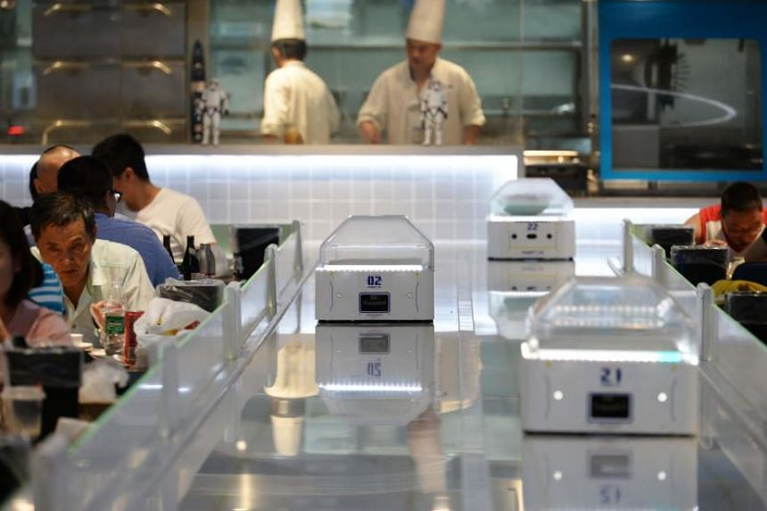 The futuristic restaurant concept is the latest initiative in Alibaba's push to modernise service and retail China.