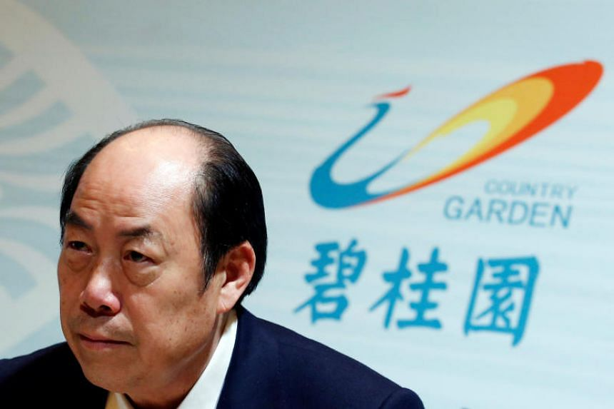 Country Garden Holdings chairman Yeung Kwok Keung  attends a news conference announcing the company's annual results in Hong Kong on March 20, 2018.