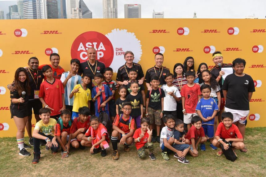 Fandi Ahmad (third from left) and former Manchester United player Wes Brown (fifth from left) at coaching clinic for 20 disadvantaged children organised by DHL Express on Aug 5, 2018.