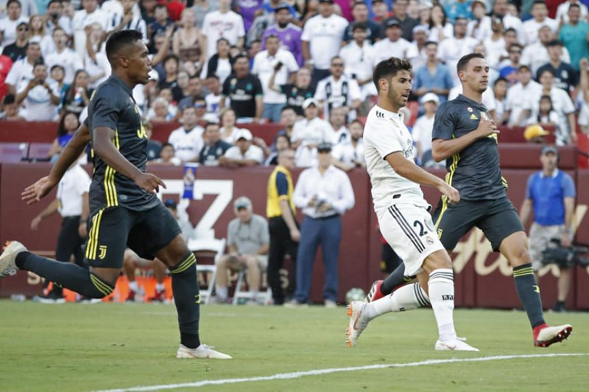 Real Madrid midfielder Marco Asensio scores a goal during the International Champions Cup match against Juventus at FedEx Field in Landover, Maryland, on Aug 4, 2018.