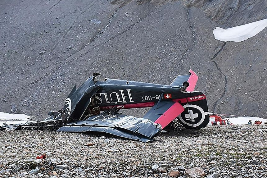 The wreckage of a vintage Junkers Ju-52 aircraft in Flims, after it crashed on Saturday on the west side of the Piz Segnas, a 3,000m peak in eastern Switzerland, killing three Austrians and 17 Swiss.