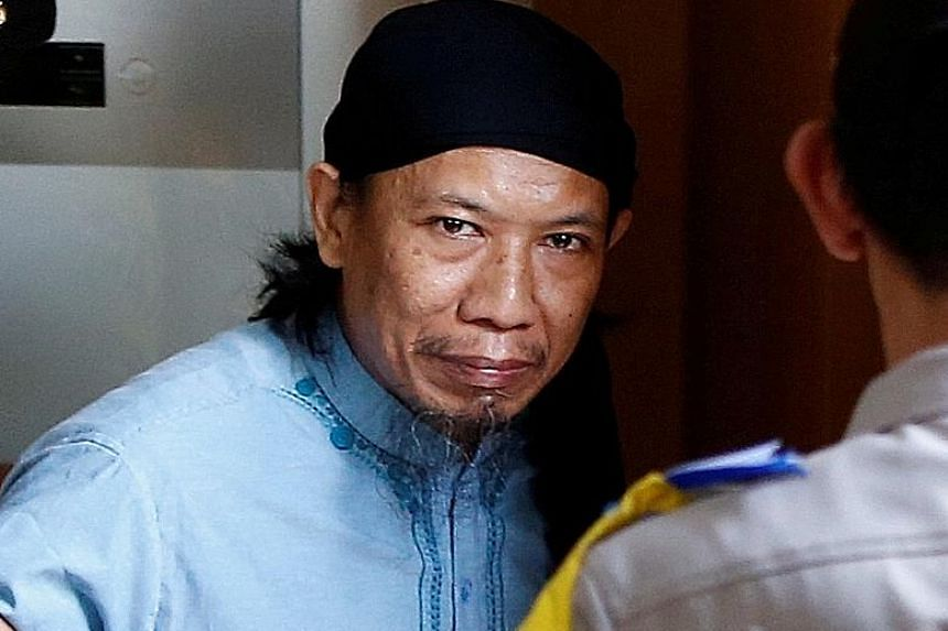 As the ranking JAD member in custody, leader Zainal Anshori was in court to answer charges.