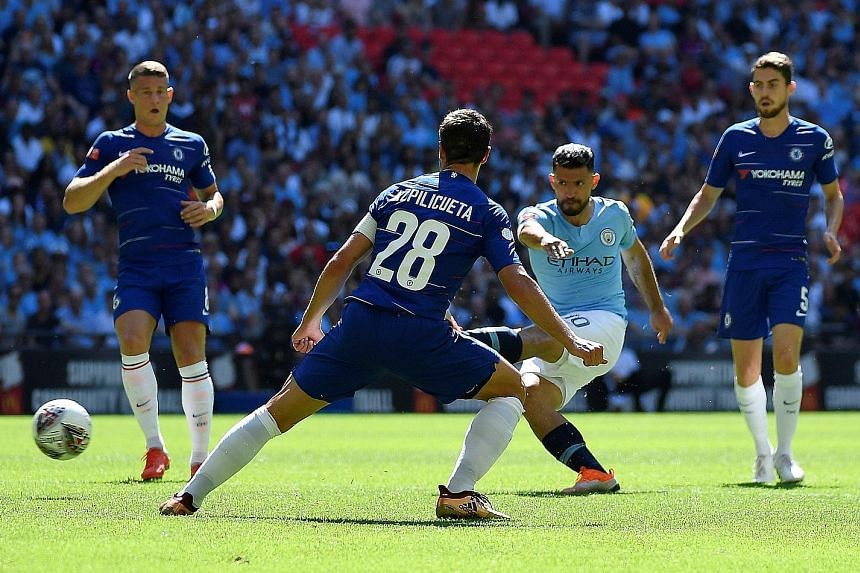 Sergio Aguero (second from right) taking just 13 minutes to claim his 200th goal for Manchester City. It was the first of his two strikes against Chelsea in the Community Shield at Wembley yesterday.