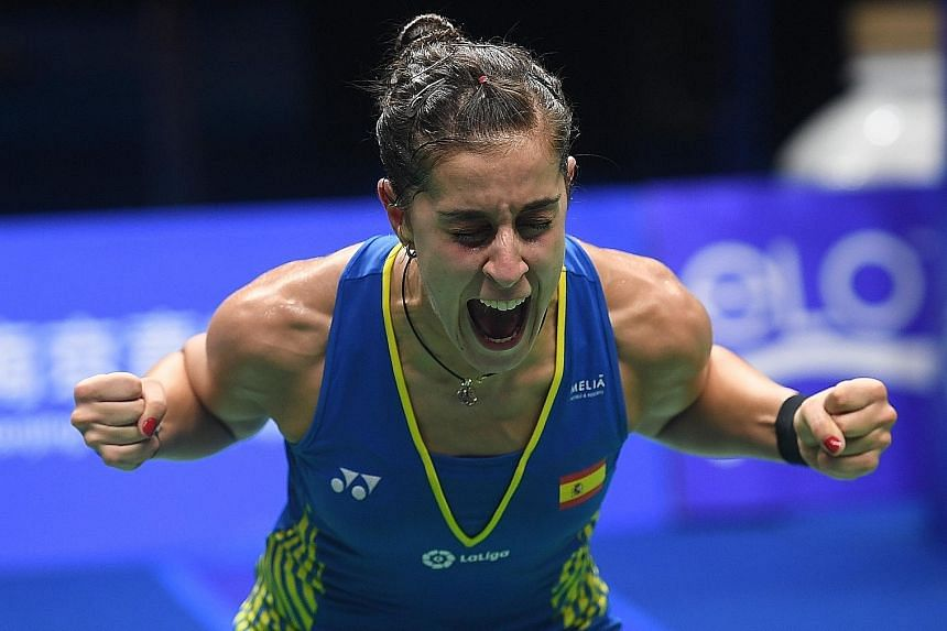 Top: Japan's Kento Momota making short work of Jiangsu native Shi Yuqi, who made a series of errors playing in front of his home crowd at the World Championships in Nanjing. Above: Spain's Carolina Marin now has three world titles to go alongside the