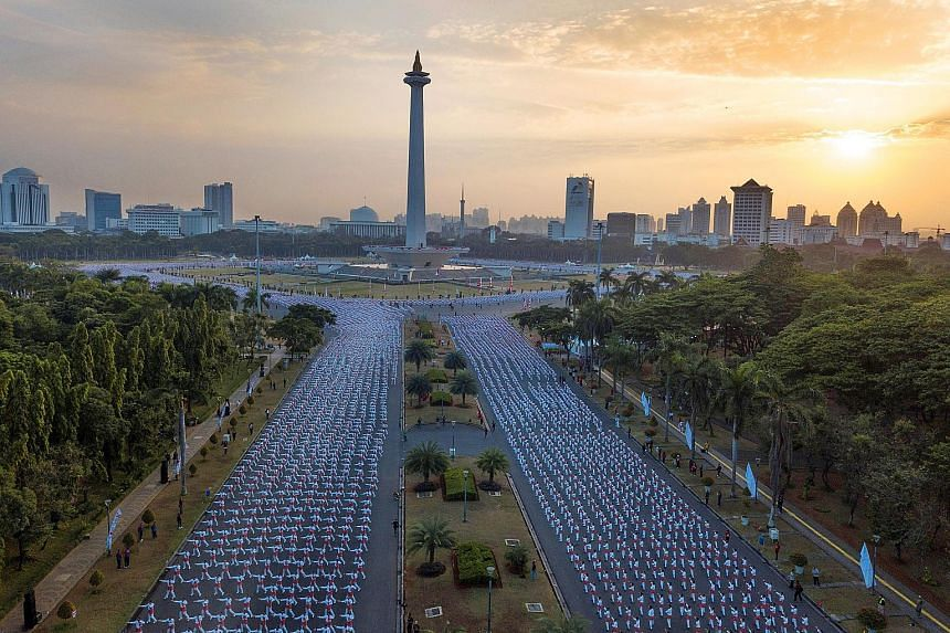 An aerial view of thousands of Indonesians participating in a traditional dance called poco-poco at the National Monument in Jakarta yesterday.