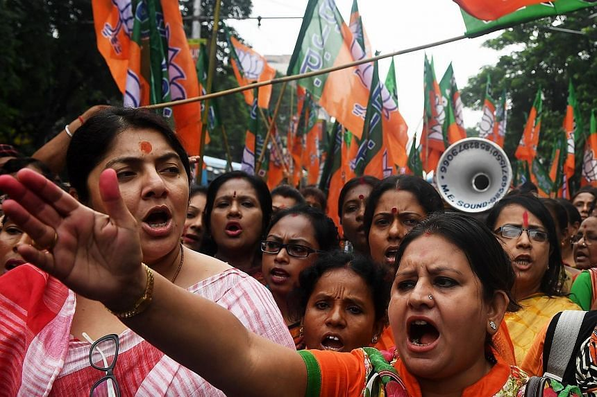 Bhartiya Janata Party activists shouting slogans last Thursday during a rally in Kolkata in support of the publication of the first complete draft of the National Register of Citizens, and against what they say was illegal immigration from Bangladesh