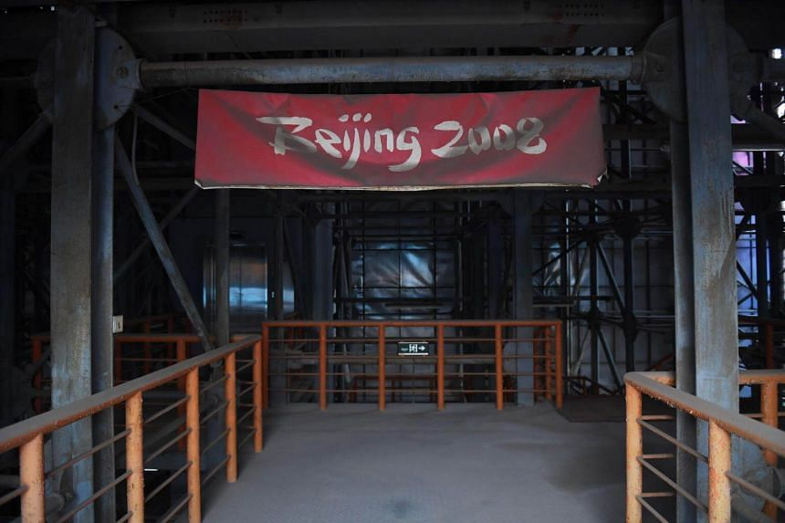 A faded Beijing 2008 sign is seen in the grandstand of the beach volleyball stadium built for the 2008 Beijing Olympic Games, on July 23, 2018.