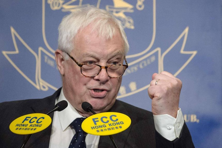 In this file picture taken on Nov 25, 2016, Hong Kong's former British colonial governor Chris Patten gestures as he speaks at the Foreign Correspondents Club in Hong Kong.
