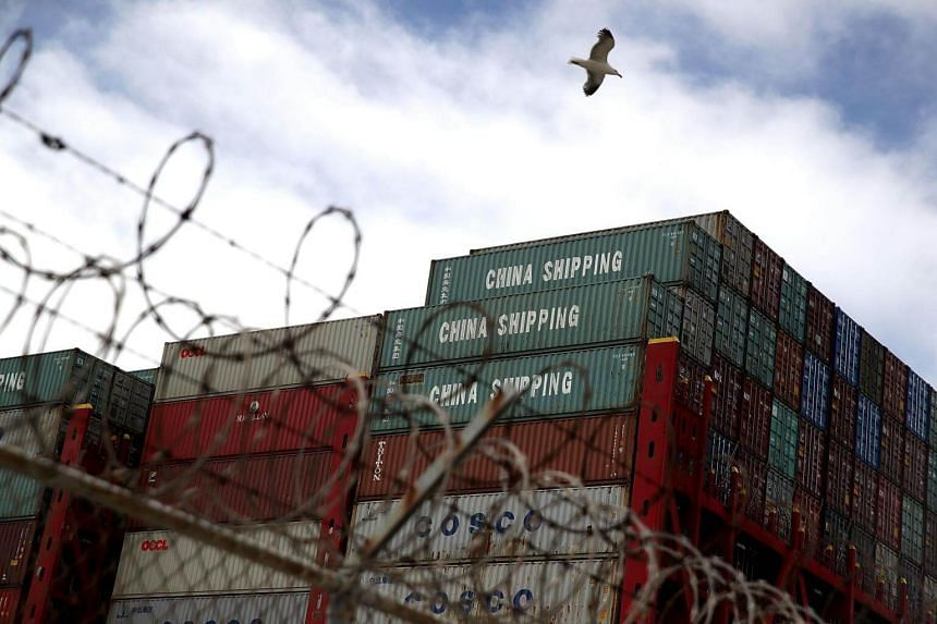 Shipping containers on the CSCL East China Sea container ship at the Port of Oakland in Oakland, California, on June 20, 2018.