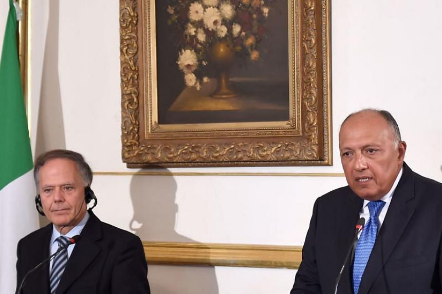 Italian Foreign Minister Enzo Moavero Milanesi (left) gives a joint press conference with his Egyptian counterpart Sameh Shoukry at El-Tahrir Palace in Cairo on Aug 5, 2018.