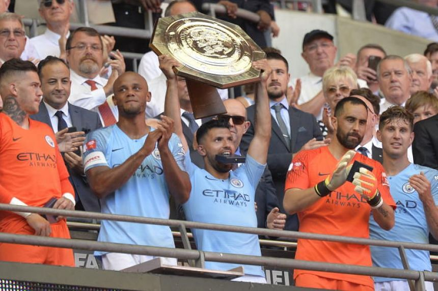 Manchester City's Sergio Aguero lifts the trophy after their win in the FA Community Shield match between Chelsea FC and Manchester City at Wembley Stadium in London, Britain, on Aug 5, 2018.