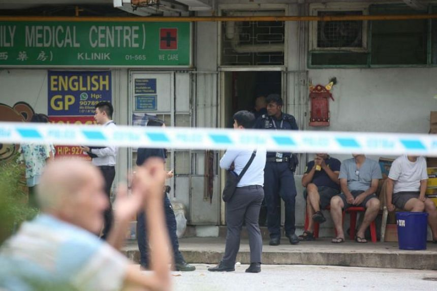 Police are seen at Ng Kian Seng Confectionery, where its elderly owner died after falling into a dough-making machine on June 25, 2018.