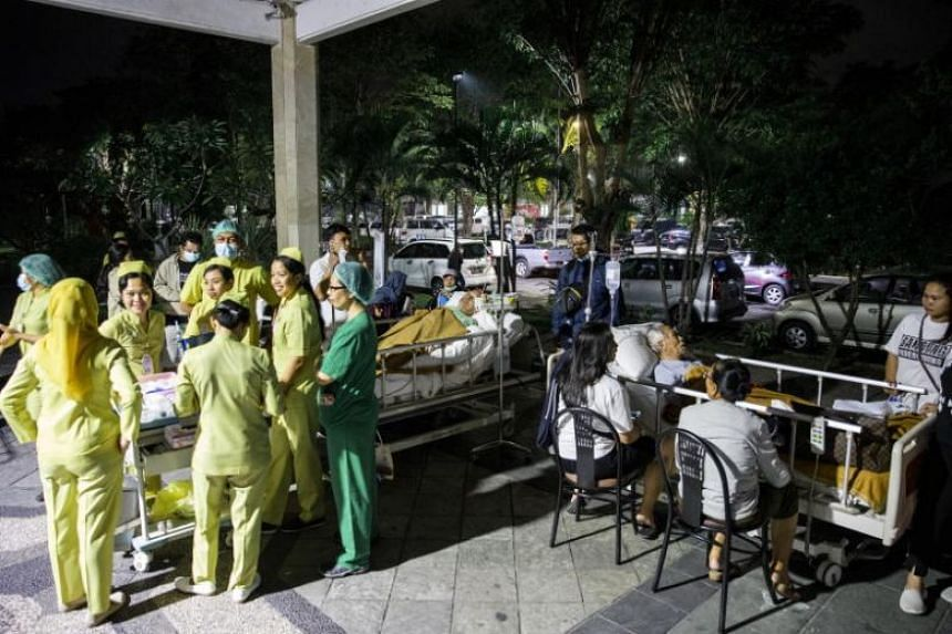 Hospital patients are moved outside of the hospital building after an earthquake was felt in Denpasar, Bali, Indonesia, on Aug 5, 2018.