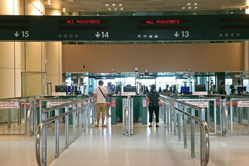 The trial, conducted at selected counters at Woodlands and Tuas checkpoints, and Tanah Merah Ferry Terminal, involves officers scanning travellers' iris images in addition to fingerprint verification.