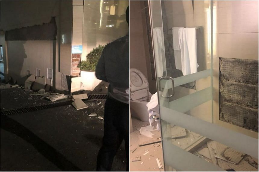 Home Affairs and Law Minister K. Shanmugam shared photos of his bathroom in his hotel room, showing wall tiles that came loose. Other photos showed buildings with cracks and shattered glass on the street.