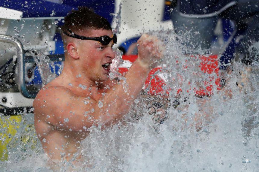 Adam Peaty of Britain celebrates at the 2018 European Championships in Glasgow, Britain, on Aug 4, 2018.