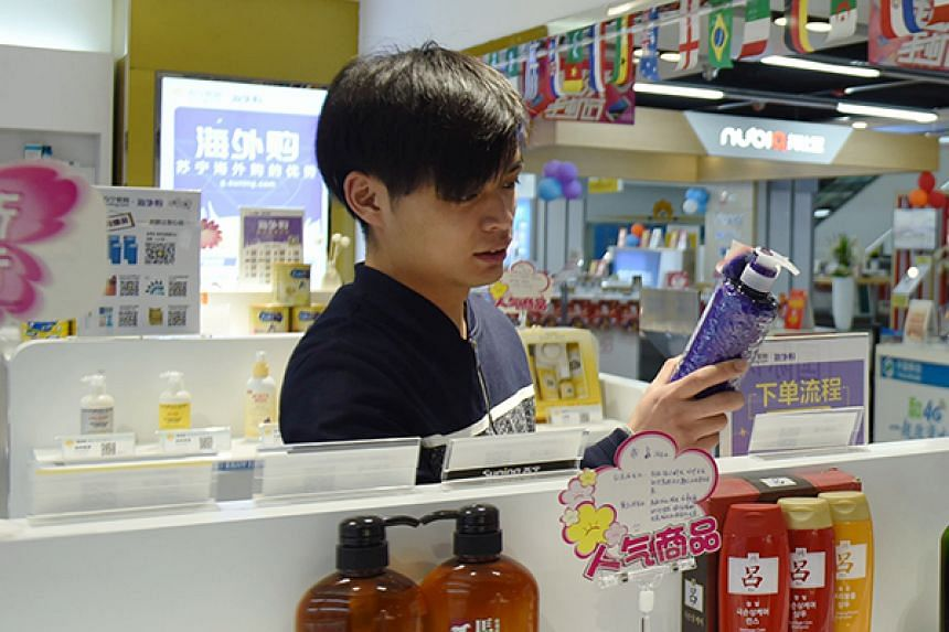 A customer shops for imported products in a cross-border e-commerce store in Hangzhou, China.