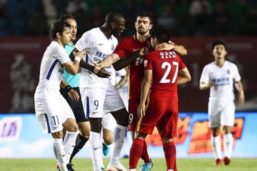 Shanghai Shenhua striker Demba Ba (centre) was embroiled in a heated exchange with Changchun Yatai midfielder Zhang Li (right) late in their 1-1 Chinese Super League draw.