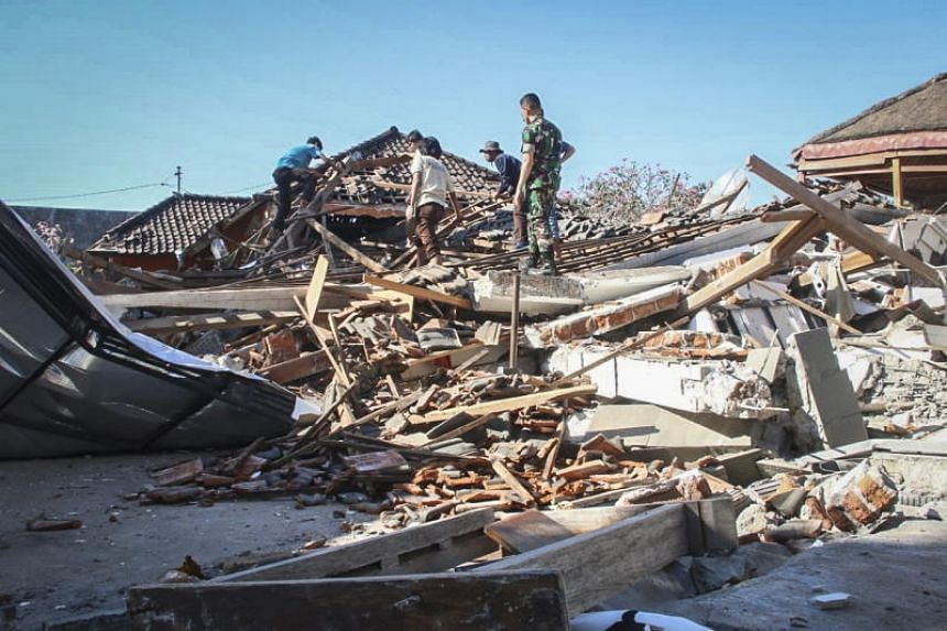 Indonesian rescuers search for victims under the ruin of a collapsed house after an earthquake struck in North Lombok, Indonesia, on Aug 6, 2018.