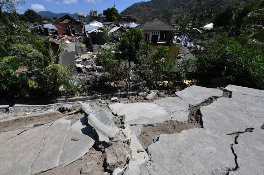 Cracked concrete and damaged houses in Pemenang in northern Lombok on Aug 6, 2018, a day after a 7-magnitude earthquake struck the area.