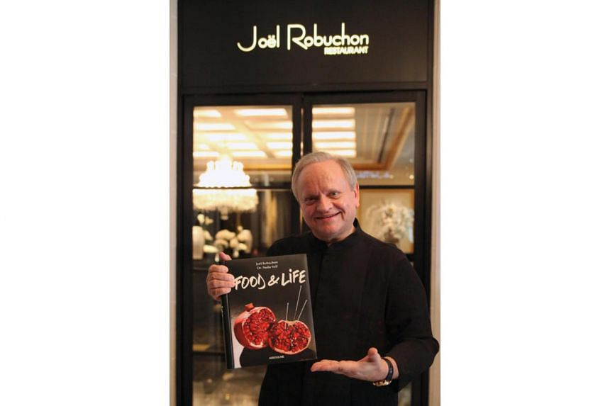 Robuchon with his book Food & Life, that was co-authored with Paris-based doctor Nadia Volf.