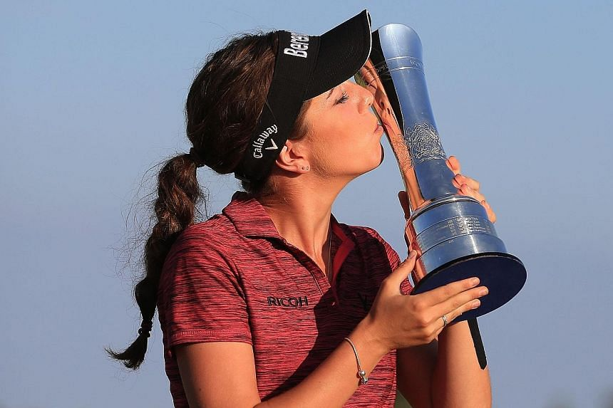 England's Georgia Hall shot a five-under 67 to win the British Open on Sunday. She finished on 17 under, two clear of overnight leader Pornanong Phatlum of Thailand.