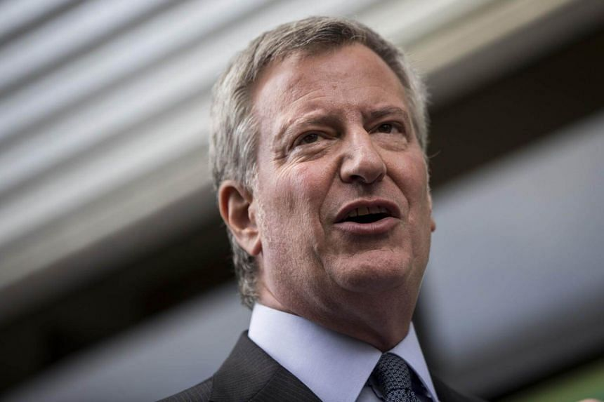 New York City Mayor Bill de Blasio speaks to the press following a visit to the Cayuga Center in East Harlem, on June 20, 2018.