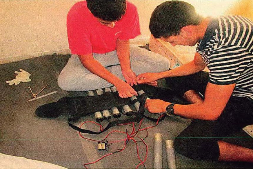 Abouyaaqouab Aalla and Hichamy, two of the terrorists who committed several attacks in Barcelona and Cambrils on Aug 17, 2017, prepare an explosive belt at a house in Alcanar in this undated photo.