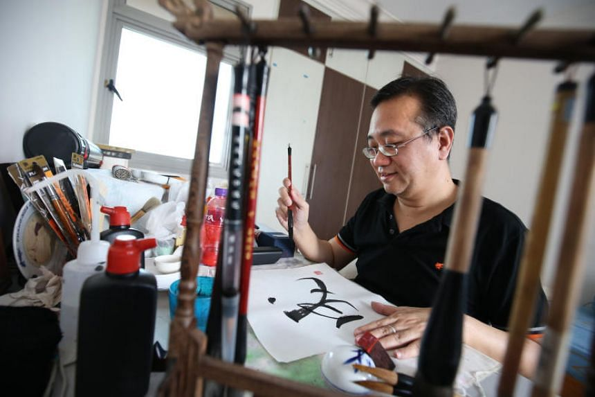 Wesley Seah, 50, is a Chinese ink painting and calligraphy artist who is completely blind in his right eye and has barely 40 per cent of vision left in his left eye.