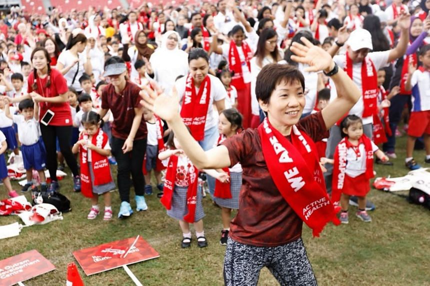 Minister for Culture, Community and Youth Grace Fu participating in a workout with thousands of pre-schoolers and parents at the National Stadium on Aug 7.