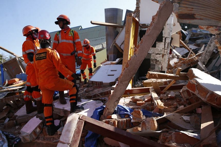 Rescuers looking for survivors after an earthquake struck northern Lombok, West Nusa Tenggara, Indonesia, on Aug 7, 2018.