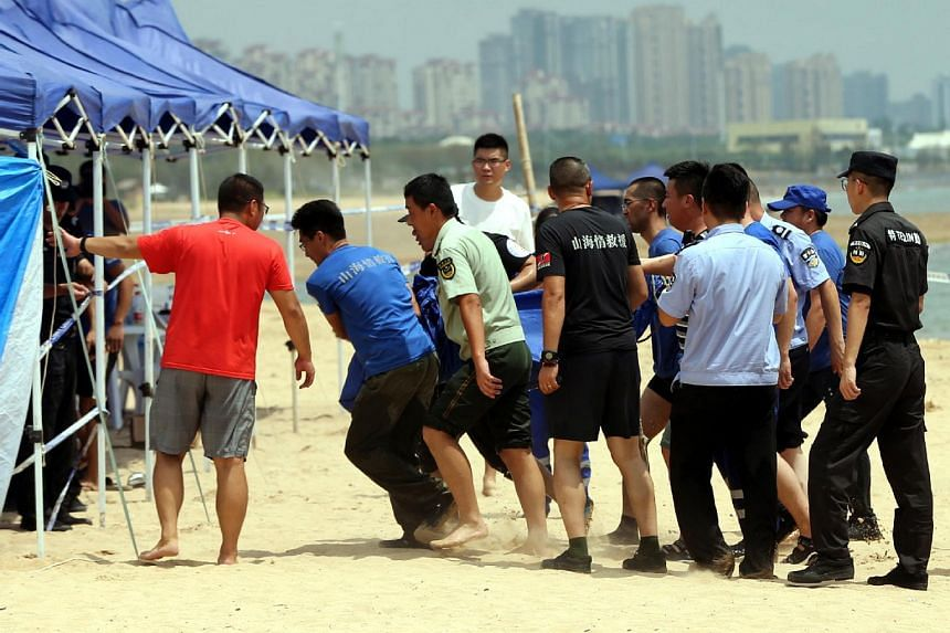 The twins went missing when they were playing on a beach in Qingdao's Huangdao district on Aug 5, 2018.