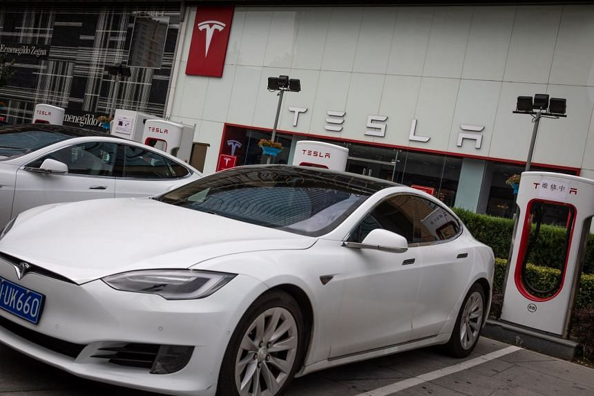 Tesla electric cars are charged at a charging station in Beijing, China.
