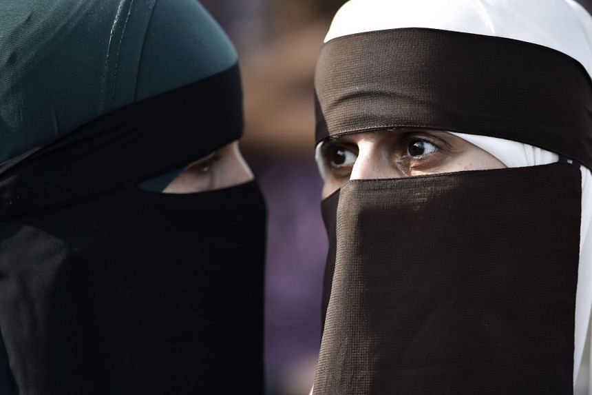 Women protest in Denmark in August 2018 over that country's implementation of a ban on face veils.