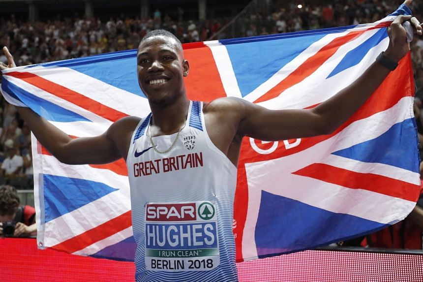 Zharnel Hughes of Great Britain celebrates winning the men's 100m final.