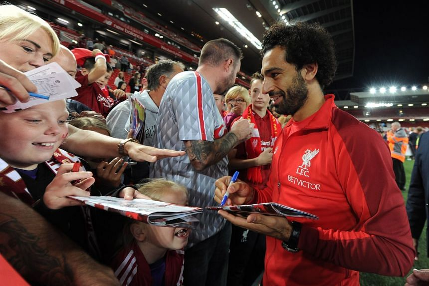 Liverpool's Mohamed Salah meeting fans after the match.