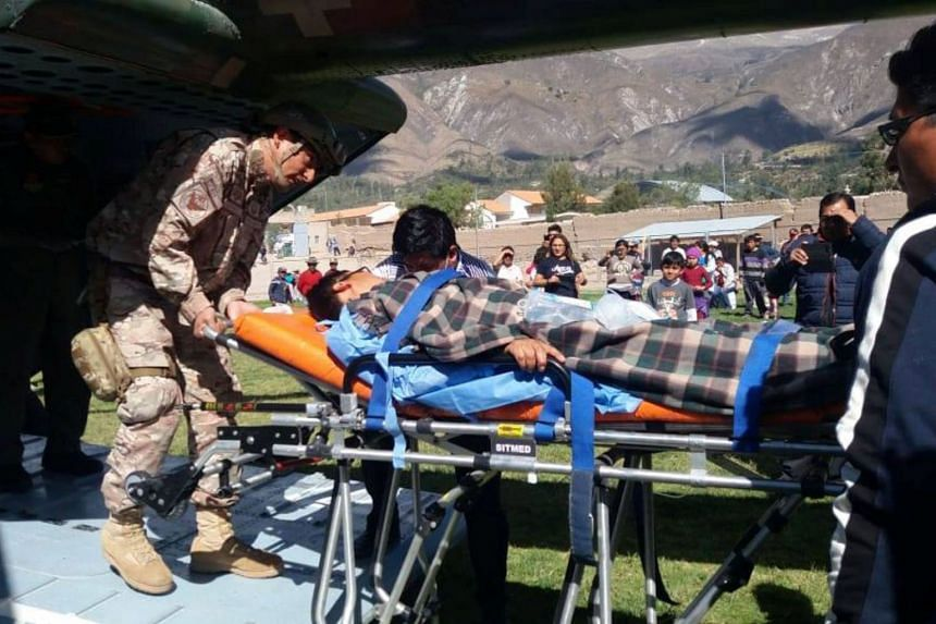 A person is transported to a helicopter after eating contaminated food at a funeral in the Peruvian Andes.