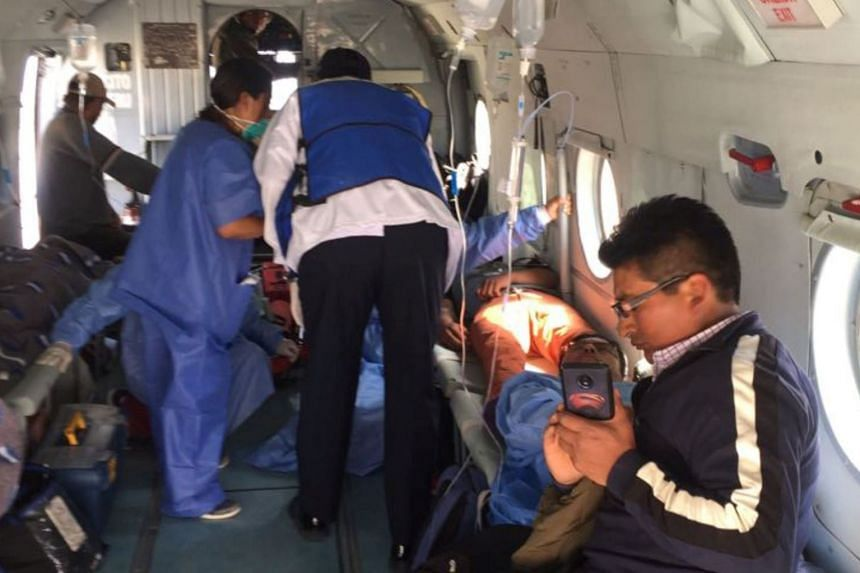 A person is transported in a helicopter after eating contaminated food at a funeral in the Peruvian Andes.