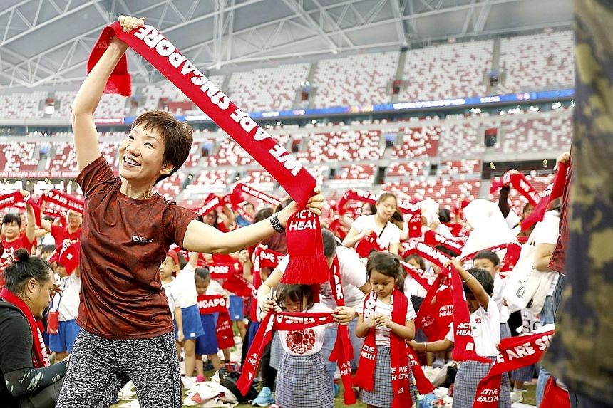 Minister for Culture, Community and Youth Grace Fu yesterday joined thousands of pre-schoolers and parents for the GetActive! Singapore group workout, choreographed to this year's National Day Parade theme song, an updated version of the 1987 classic